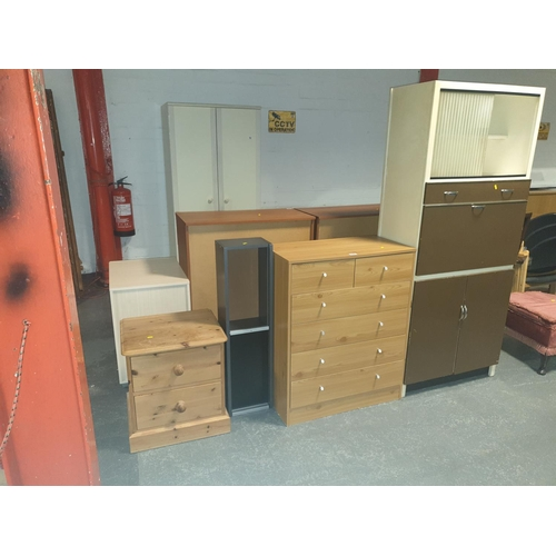 832 - A kitchen larder unit, a chest of drawers, pine bedside cabinet etc....