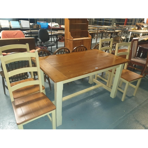 841 - A pine dining table and four chairs....