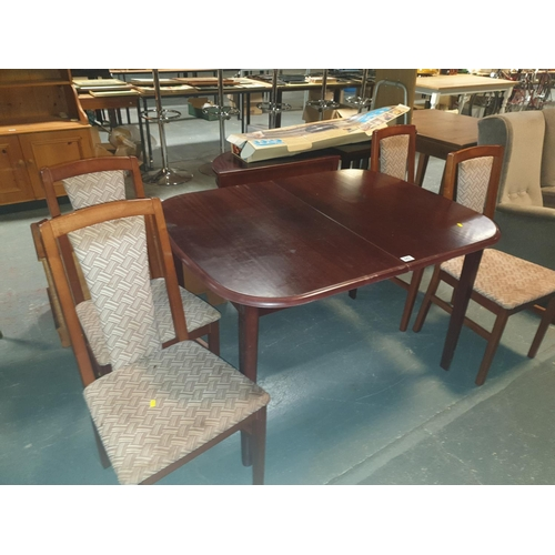 842 - An extending dining table and four chairs....