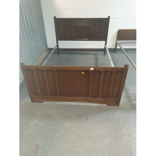 894 - A wooden double bed frame (no mattress)...