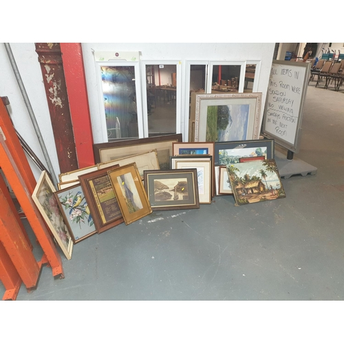 898 - A quantity of framed pictures and mirrors...