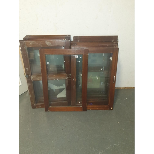 900 - A quantity of glass fronted cabinet doors...