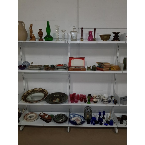 51 - Eight shelves of china, glass and ornaments, including Wade and Cranberry glass...
