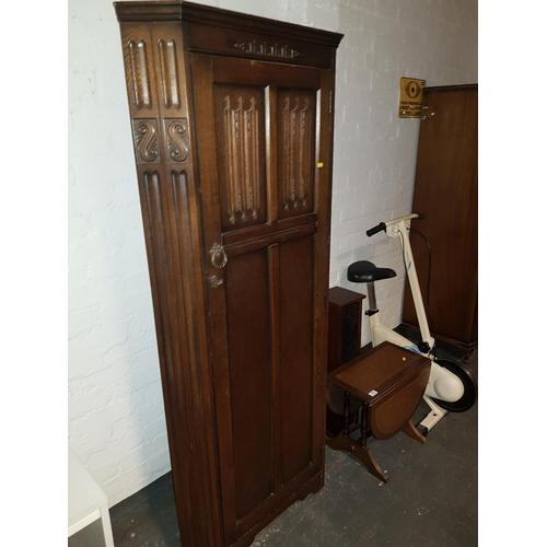 312 - An oak corner unit, exercise bike, drop leaf table, etc...