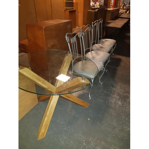 321 - A glass top table and four chairs...