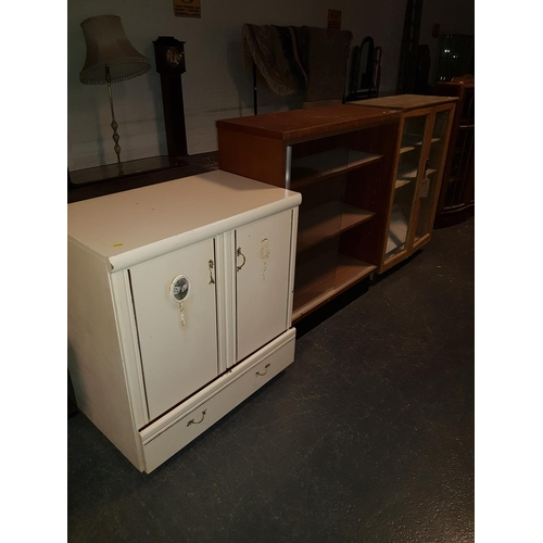 338 - A small cupboard and two glass fronted bookcases...