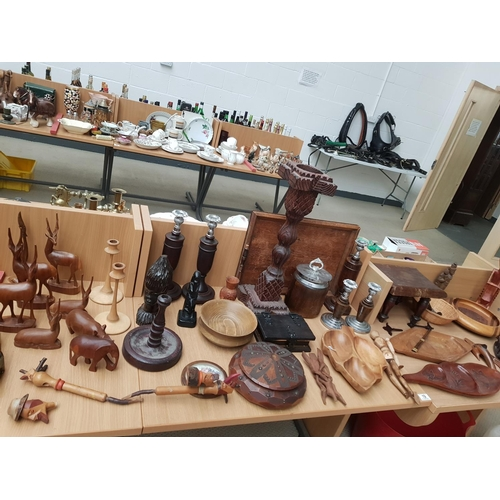 19 - A selection of treen including candlesticks, bowls etc...
