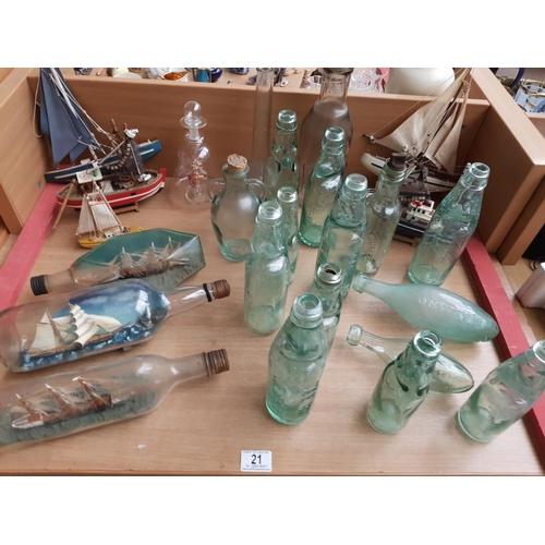 21 - Glass bottles, ships in bottles, wooden yachts etc...