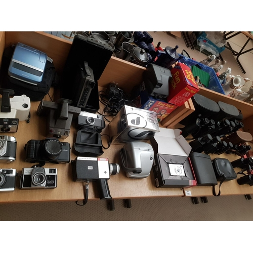 22 - A selection of vintage cameras, binoculars and movie cameras to include Eumigette 2, Super 8, Polaro...