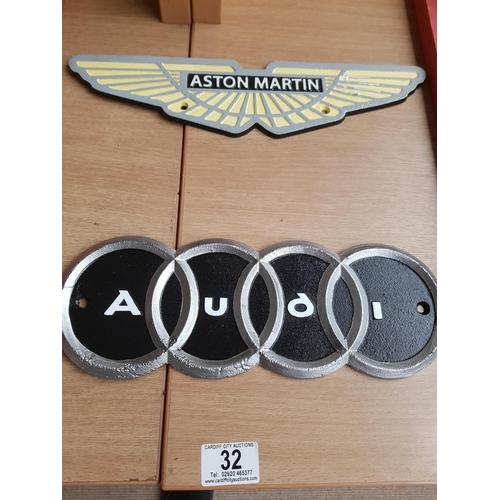 32 - Cast iron Astin Martin and Audi Signs...