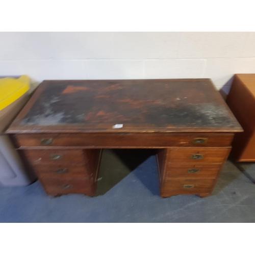 201 - An oak twin pedestal desk...