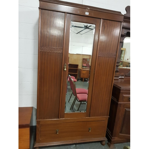 205 - A mahogany single door wardrobe...
