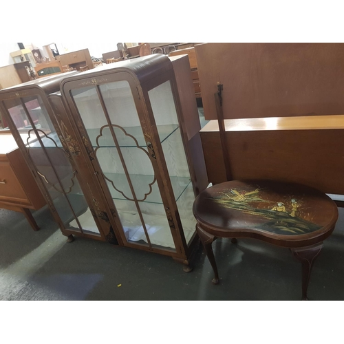 209 - A display cabinet and a small table