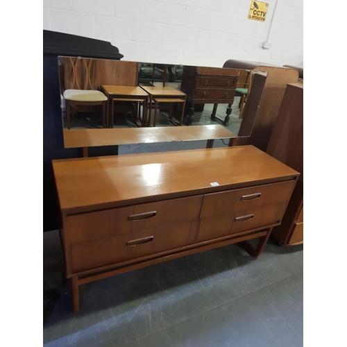 213 - A mid century modern teak dressing table...