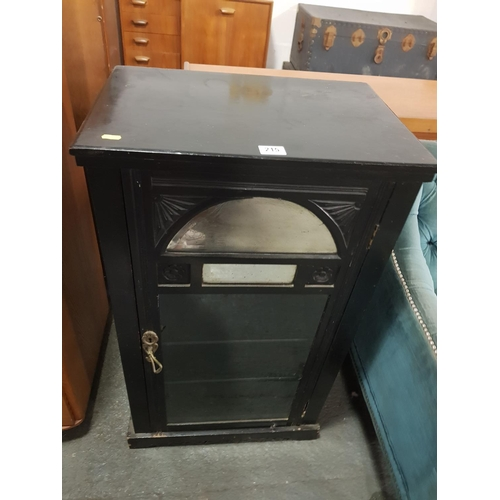 215 - An ebonised 1920's cabinet...