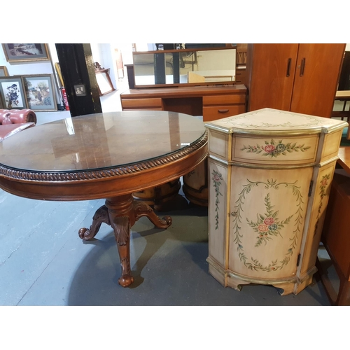 237 - A glass top circular dining table and a painted cabinet...