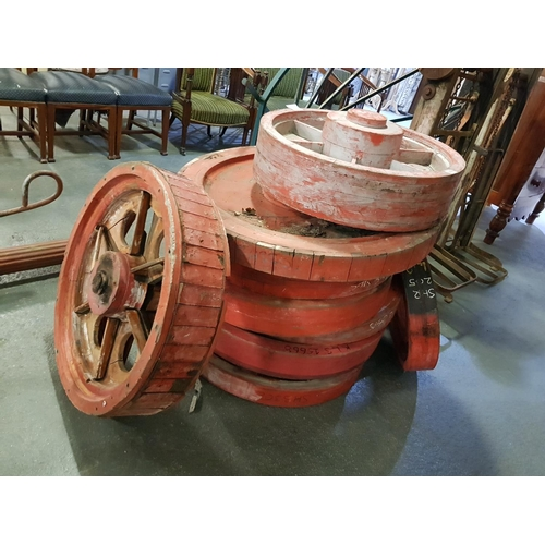 209 - A collection of decorative wooden wheels...