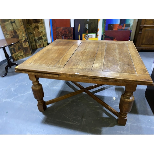 106 - A large oak draw leaf table...
