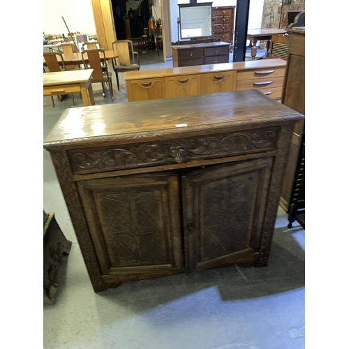 119 - A carved oak Victorian sideboard with two doors and single drawer...