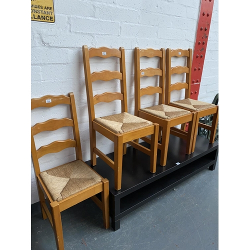 302 - Four pine dining chairs and a coffee table...