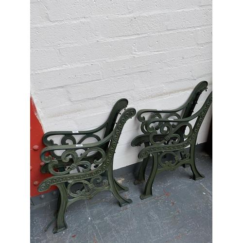 303 - Four cast iron bench ends...