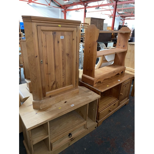 319 - A pine bookcase, corner cabinet and two pine TV stands...