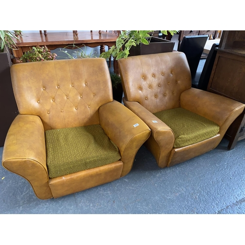 331 - A pair of orange leather armchairs...