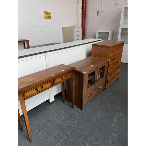 344 - A chest of drawers, hall table and a cabinet...