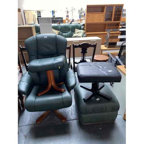 346 - A green leather armchair and three stools...