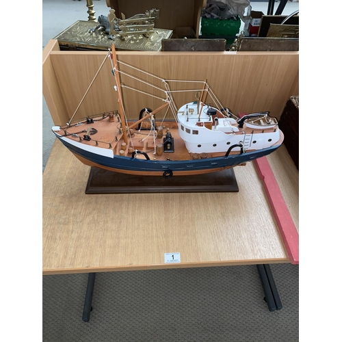 1 - A wooden model of a fishing boat...