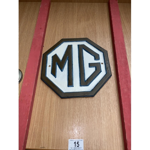 15 - A cast iron MG car wall plate...