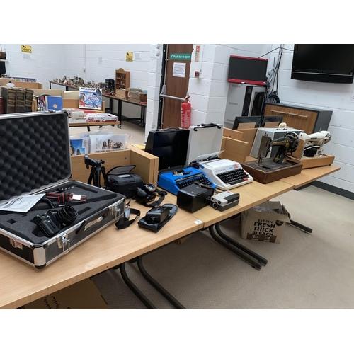 17 - Vintage typewriters, sewing machines, cameras etc....