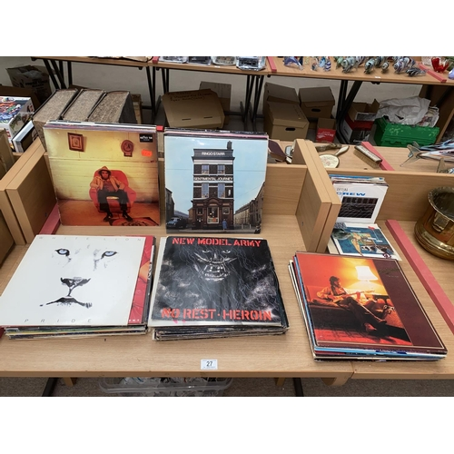 27 - A selection of mixed  vinyl albums and singles including Ringo Starr, Iron Maiden, Eric Clapton etc....