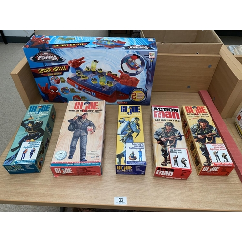 33 - Boxed G.I Joe and Action Man figures and a boxed Spiderman play set...