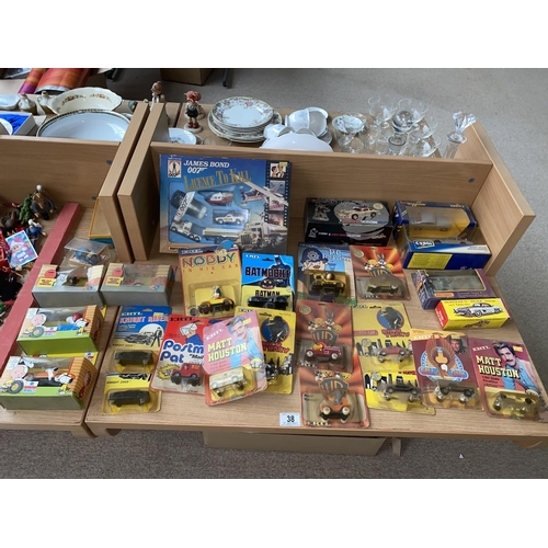 38 - Boxed film and tv related vehicles including James Bond,Snoopy etc....