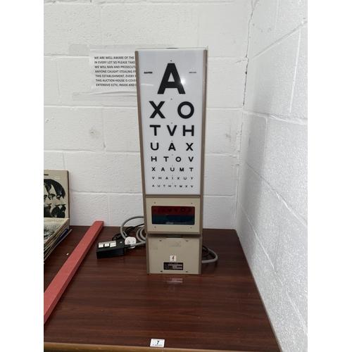 7 - A Rayner revolving opticians motorised light box - 1960's...