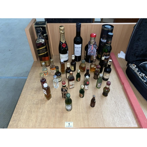 1 - A collection of alcohol to include boxed Johnnie Walker black label, Glenfiddich special reserve, Mo...