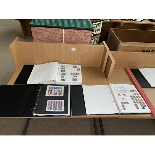 23 - Three stamp albums containing stamps from France, Yugoslavia and Italy...