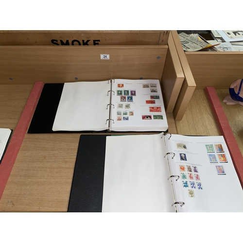 24 - Two stamp albums containing stamps from East Germany and Berlin...