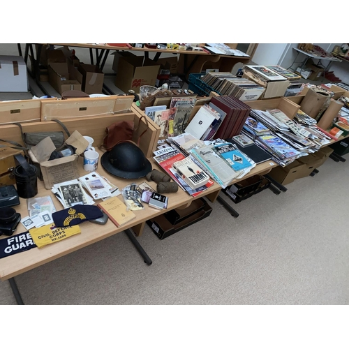 29 - Assorted militaria artefacts including gas mask, wardens helmet, lamps , armbands, badges, buttons, ...