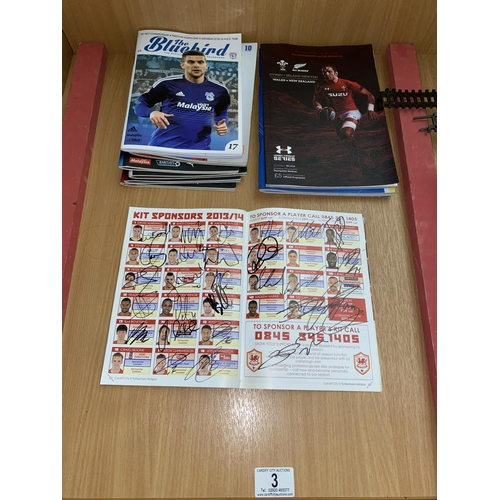 3 - Cardiff City football programs including a 2013 team signed programme...