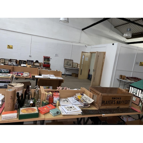 30 - A large copper shop sign, 1.5 rolls of shop wrapping paper (Bridgend) , advertising tins and bottles...