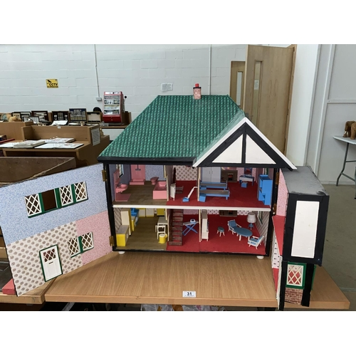 31 - A dolls house with furniture...