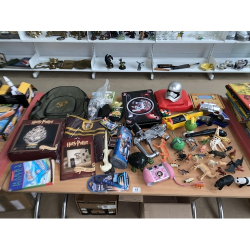 41 - A collection of mixed toys and games including Harry Potter, Lego, plastic animals, Vtech camera etc...