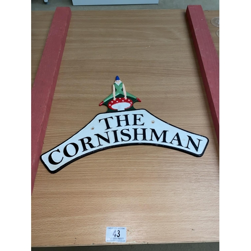 43 - A cast iron The Cornishman wall plaque...