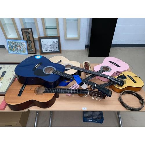45 - Five acoustic guitars including children's, vintage tambourine etc....