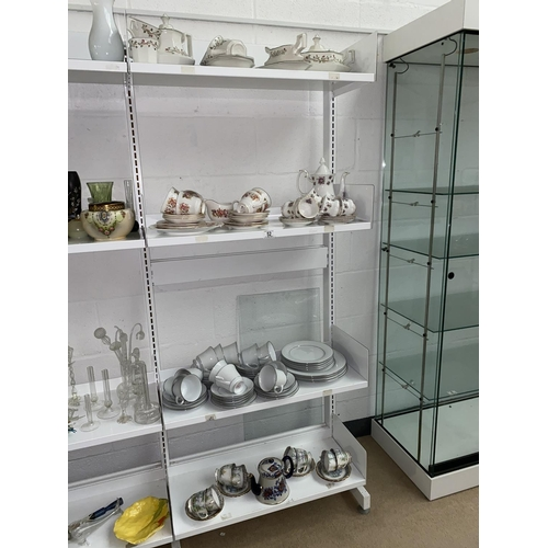 52 - Part tea sets including Royal Albert- 4 shelves...