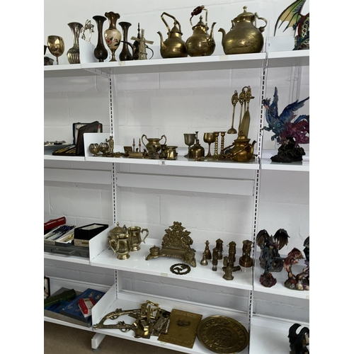 55 - A quantity of mixed brassware including inkwell, tea pots etc. - 4 shelves...