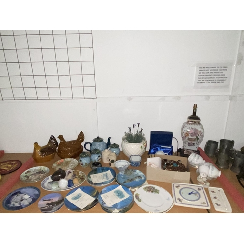 60 - A collection of china to include Wedgwood Peter Rabbit clock and barometer, part tea set, lamp, cost...