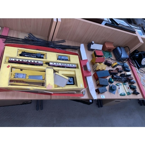 4 - A collection of Hornby and Triang OO gauge model train items- engines, track, buildings, transformer...
